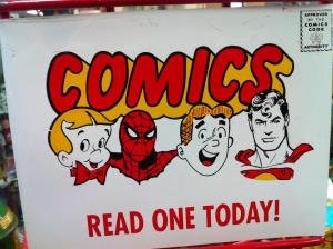 Photograph of vintage illustration featuring classic comics characters with the text COMICS: READ ONE TODAY!