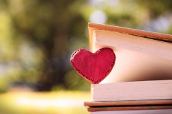Lover Book by flickr user Hazel Marie. Shows a red heart held between the pages of a book