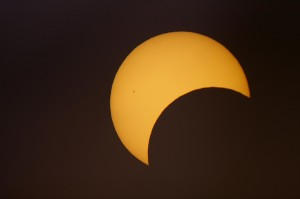 A photograph of a partial solar eclipse